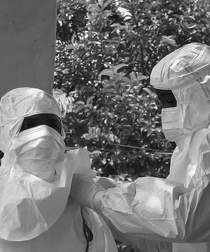 People dressed in ebola protection suits
