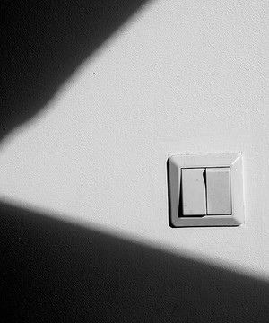 Light switch in a darkened room.