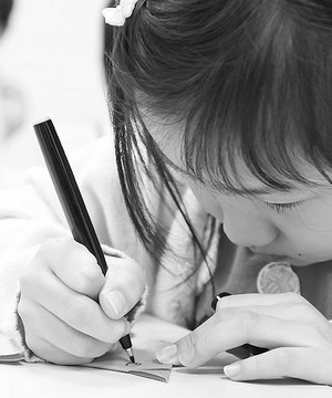A child drawing on paper