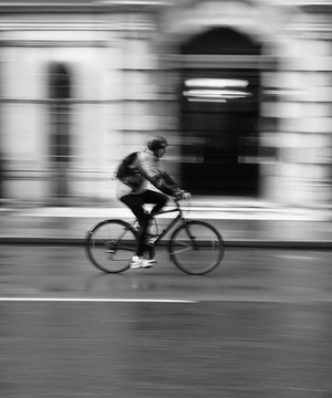 Cyclist cycling along a street