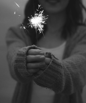 Woman holding a sparkler.