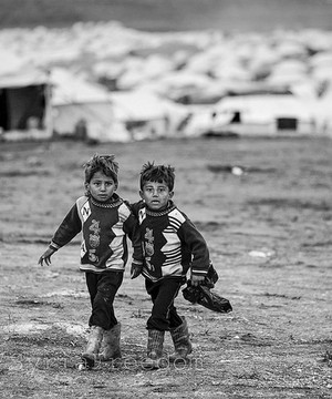 Two young Syrian refugees in refugee camp.