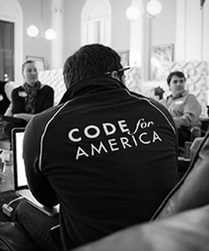 Code for America seminar with engaged delegates having a discussion.