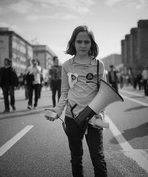 A young girl taking part in a street protest