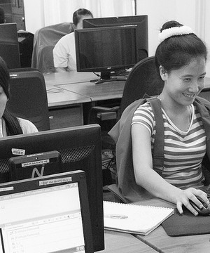 Young Asian women working on computers