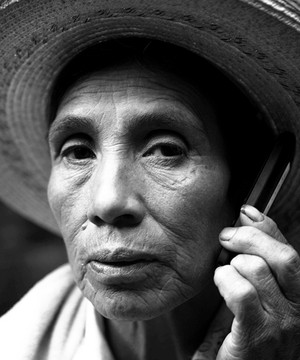 Peruvian woman on mobile phone