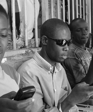 African men using mobile phones