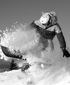 Young guy snowboarding