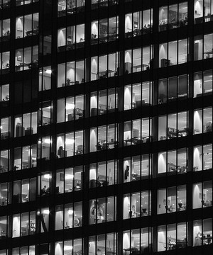 Office windows lit up at night