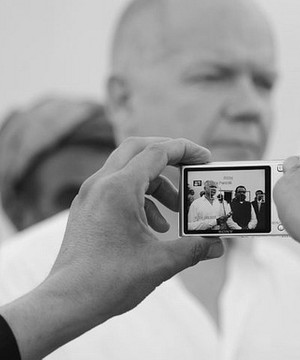 William Hague being filmed on a mobile during a visit to Helmand, Afghanistan