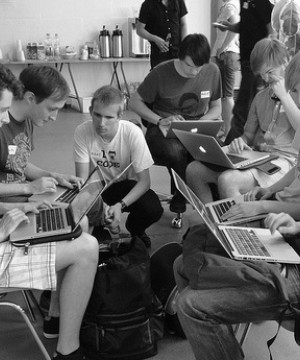 A group of young men coding at a Randon Acts of Kindness event in Berlin in 2011