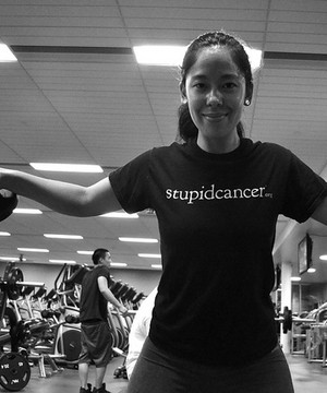Young woman wearing 'Stupid Cancer' t-shirt