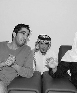 Saudi Arabian friends together watching TV