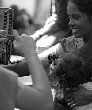 An Indian woman and her child attending a health centre