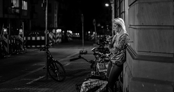 Girl on phone at night alone