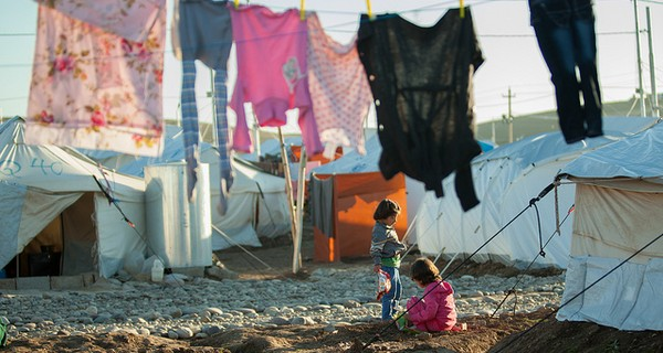 Two children playing in Syrian refugee camp.