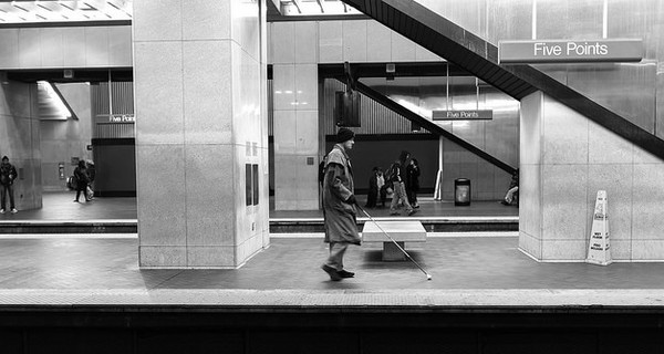 Blind man on a train platform