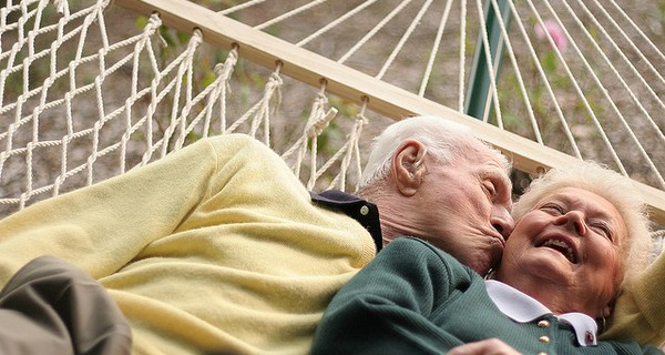 Older couple laying in a hammock together