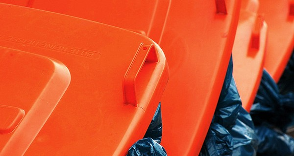 Row of orange dustbins