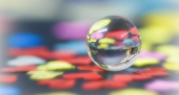 Glass ball reflecting colours