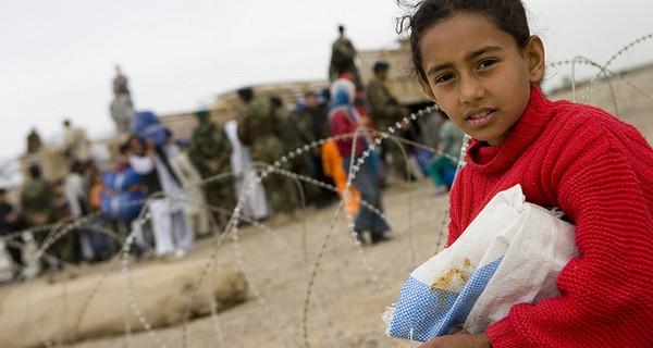 Young girl receiving humanitarian aid.