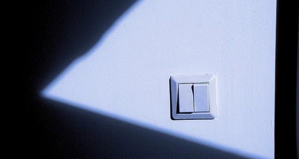 Light switch in a darkened room.