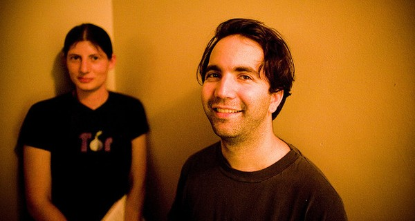 BitTorrent creator Bram Cohen smiling at the camera  with a young woman in the background