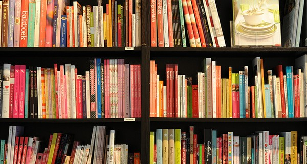 Book shelves full of books with colourful covers