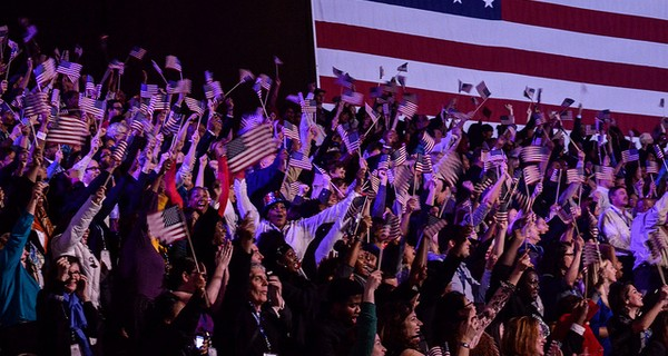 Crowd at Presdient Obama's Election Night Rally wave USA flags