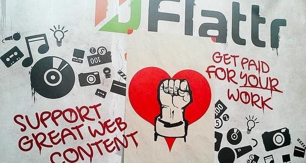 Graffiti wall branded with Flattr logo and slogans