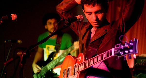 Close up of a guitarist at a music concert