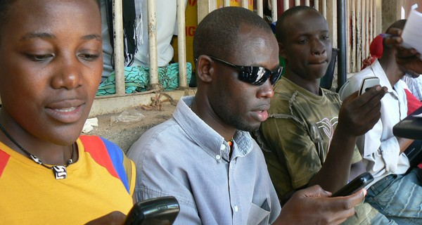 African men using mobile phones