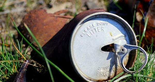 A rusty can in the grass