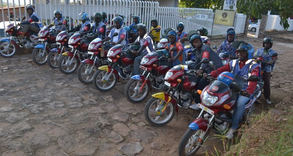 A row of people of motorcycles in Africa