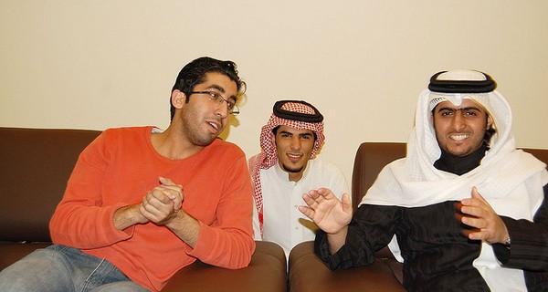 Saudi Arabian friends together watching TV