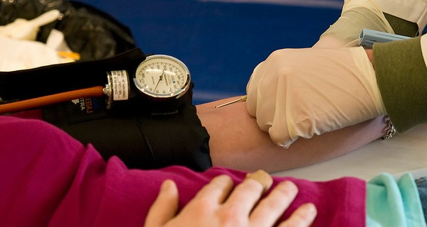 Close up on someone's arm while giving blood