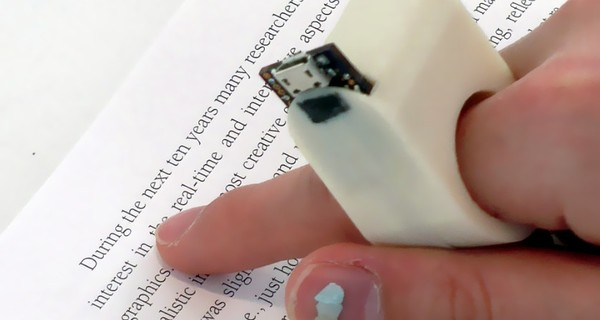 Image of someone using their finger to read