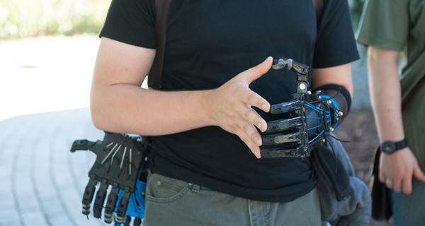 A recipient of a 3D prosthetic hand at and e-NABLE workshop